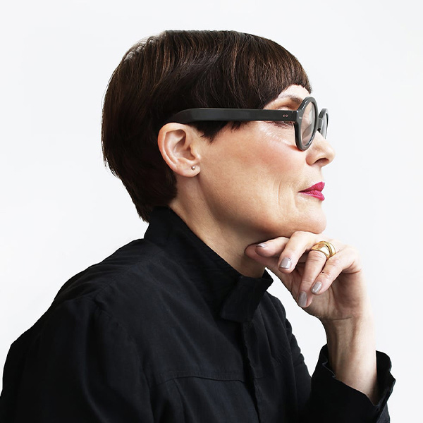 side profile of founder Mary Futher with short hair and round glasses